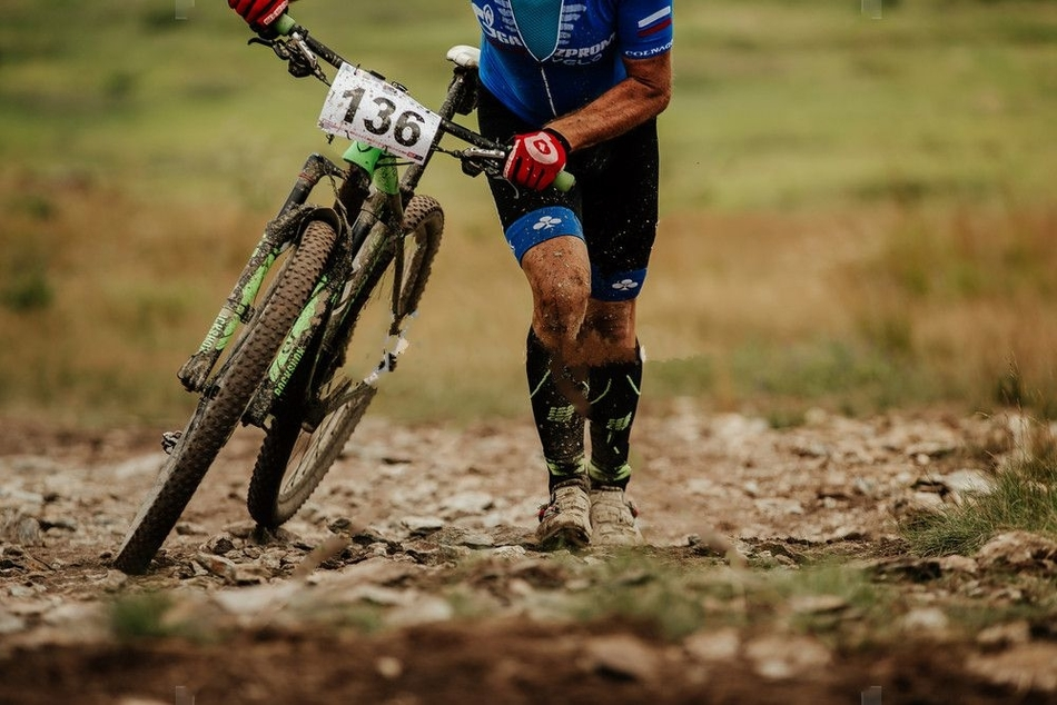 why do mountain bikers wear long socks